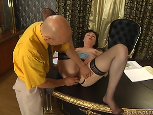 Mature woman has her butt plugged