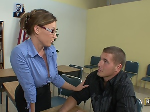 Sexy teacher stuffed on her own desk