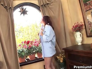 Redhead cutie inserting big glass dildo