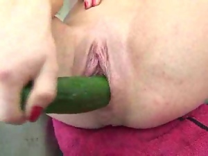 Amateur and her cucumber masturbation