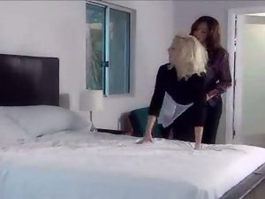 Threesome happens with blonde and brunette women on soft white bed
