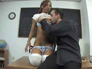 Teen brunette in white stockings gets naughty in the classroom and fucks cock