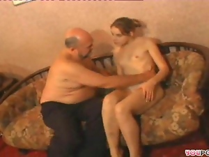 Sexy brunette talks on mike and then fucks old guy on soft bed