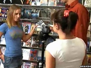 Sexy brunette fucks in public nudity inside small store