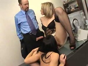 Brunette and blonde in black stockings fuck in office place