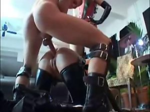 Sexy women fuck in a foursome with strapons