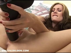 Sexy Brandi stuffs her pussy with large brutal dildos