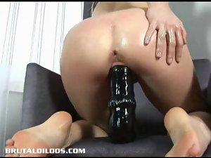 Hottie destroys pussy with long dildo