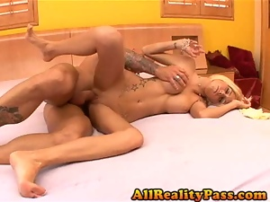 Blonde deep throats cock while feet are sucked