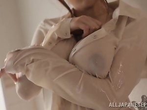 Desirable Asian babe rubs and sucks that huge cock in the shower
