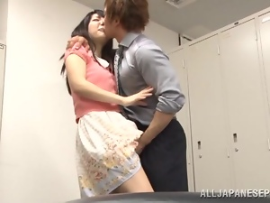 Japanese cutie rides her BF's dick in the locker room