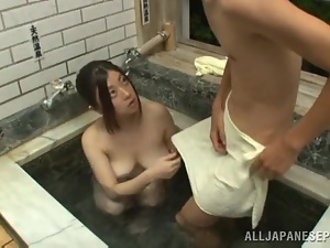 Busty Japanese bitch blows and gets fucked in a bathroom