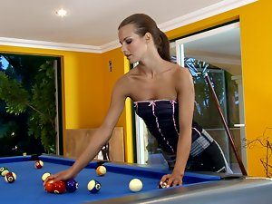 Long-Haired Babe Masturbates Her Pussy on a Pool Table