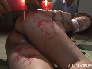 Reiko Sawamura enjoys hot wax on her big natural tits