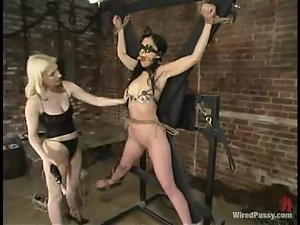 Sybian Ride in Bondage Session for Submissive Brunette Lesbian