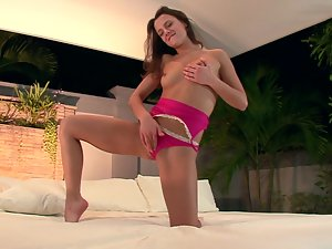 Honey bends over and starts poking her tight muff with her fingers