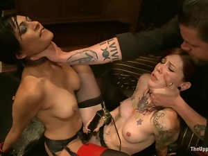 Hot brunette slave gets tied up and punished in a crowded room