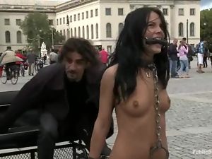 Kinky brunette walks naked in the street and gets fucked