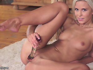 Sexy blonde babe Dido Angel enjoys toying her pussy near the stairs