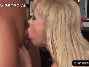 Blonde mature tramp eats hard cock on knees