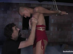 Bald girl gets bounded and then fucked in her pussy