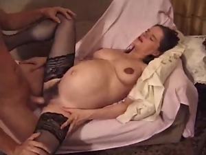 Pregnant brunette toys her hairy cunt after getting it hotly fucked