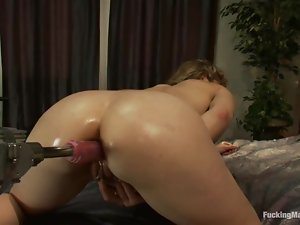 Kinky lesbians are stimulating each other with a fucking machine