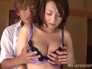 Japanese milf shows off her awesome boobs and licks a prick