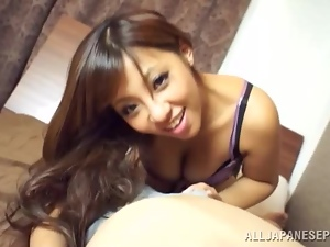Beautiful Japanese girl gives a blowjob and rubs the dick against her tits