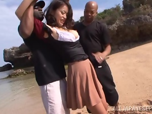 Japanese hottie gets threesome at the beach by Black guys