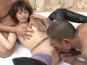 Pretty Japanese girl enjoys sucking and riding two hard pricks