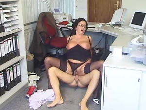 Mature brunette woman gets nailed in an office