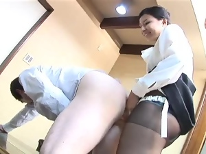 Hot Asian dominatrix drills some guy's ass with a strap on