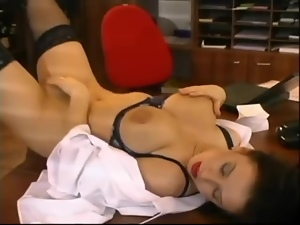 Busty brunette secretary enjoys doggy style sex on a desk