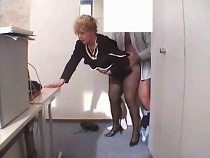 Mature blonde woman gets fucked from behind in the office