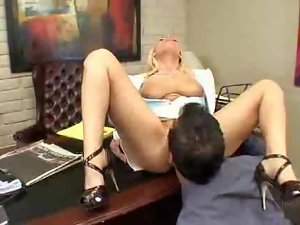 Blonde MILF gets a mouthful after hot sex on an office table