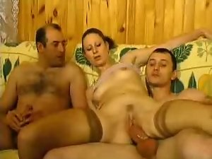 Slutty bitch in stockings gets fucked in MMF threesome
