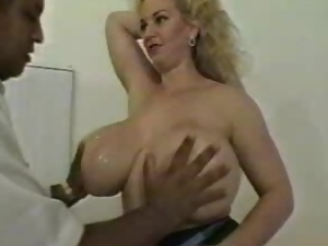 Big-breasted mature blonde satisfies a few horny studs