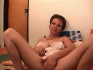 Lewd granny plays with her big natural tits in front of a webcam