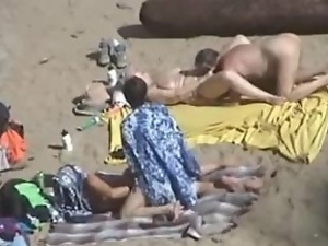 Girl gets her pussy fingered by her husband on a nude beach