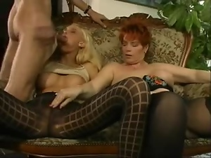 Two horny sluts do all what they can to satisfy some horny stud
