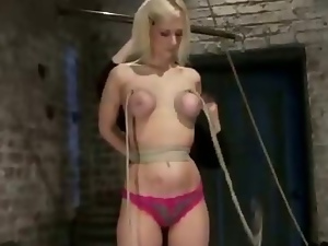 Blonde tape gagged with panties in mouth and tits bound and weighted