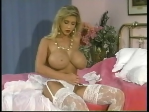 80s pornstar with huge tits rubs lotion into her skin