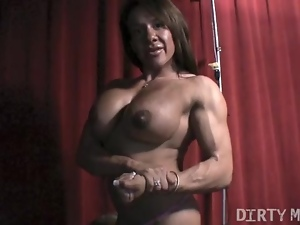 Female Bodybuilder Rubs Big Clit