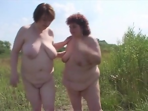 Fingering fat ladies on a picnic outdoors