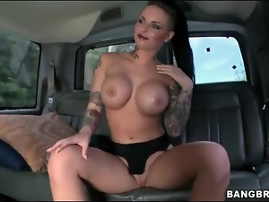 Tattooed Christy Mack strips in the car