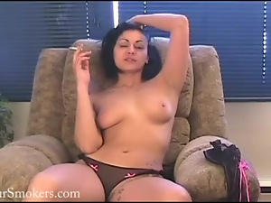 Short haired cougar has a smoke topless