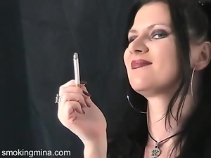 Dark makeup and lipstick on smoking goth girl