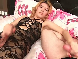 Sexy shemale in fishnet outfit jerking off