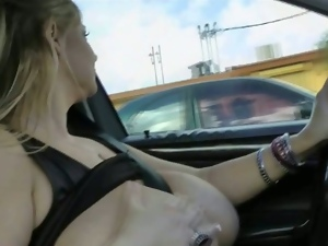 Blonde bbw sucks her massive tits while driving